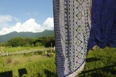 Thaise zijde op de rijstachtergrond royalty-vrije stock afbeelding