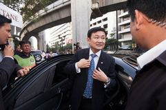 Thaksin Shinawatra gets off a car. stock images