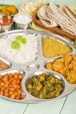 Thali. South Asian selection of vegetarian curries and rice served in a traditional dish. Taka dahl, gobi masala, palak paneer, chana masala and dahl makhani Stock Photo