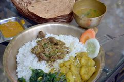 Thali - traditional Indian, Bengali and Nepalese food. Thali  is an Indian, Bengali and Nepalese meal made up of a selection of various dishes Royalty Free Stock Photography
