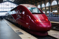 Thalys train at the station Gare du Nord in Paris. Paris, France - October 21, 2016: Thalys train and unidentified people at the station Gare du Nord in Paris Stock Images