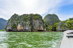 Tham Lod cave Phang Nga bay. Beautiful landscape of island sea and sky in summer as tourists are happy with the canoeing at Tham Lod cave in Ao Phang Nga Bay Royalty Free Stock Image
