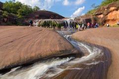 'Tham Phra' Waterfall Bungkan thailand. BUNGKAN, THAILAND - August 22, 2015: Unknown person, 'Tham Phra' Waterfall, People are playing waterfall. Bungkan 2015 Stock Photo
