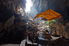 Tham Phu Kham cave near Vang Vieng. Laos. Bronze Thai Buddha in Tham Phu Kham cave near Vang Vieng. Laos. The cave is revered by the locals and contains several Royalty Free Stock Images
