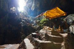 Tham Phu Kham cave, Vang Vieng, Laos. Reclining Buddha statue in Tham Phu Kham cave, Vang Vieng, Laos Stock Images