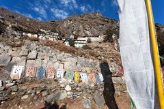 Thame gompa with prayer flags - monastery in Khumbu Stock Image