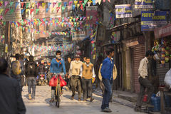 THAMEL, KATHMANDU, NEPAL - NOVEMBER 20, 2014: Bicycle driving by Royalty Free Stock Images