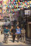 THAMEL, KATHMANDU, NEPAL - NOVEMBER 20, 2014: Bicycle driving by Stock Photography