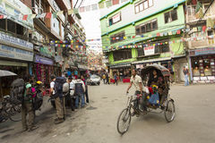 THAMEL, KATHMANDU, NEPAL - NOVEMBER 19, 2014: Rickshaws driving Stock Images