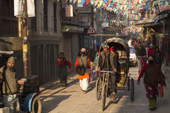 THAMEL, KATHMANDU, NEPAL - NOVEMBER 20, 2014: Rickshaws driving Stock Photos