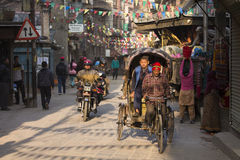 THAMEL, KATHMANDU, NEPAL - NOVEMBER 20, 2014: Rickshaws driving Stock Images