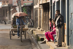 THAMEL, KATHMANDU, NEPAL - NOVEMBER 20, 2014: Rickshaws driving Royalty Free Stock Images
