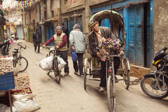 THAMEL, KATHMANDU, NEPAL - NOVEMBER 29, 2014: Rickshaws driving Stock Image