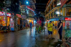 THAMEL, KATHMANDU NEPAL - OCTOBER 02, 2017: Unidentified people walking and buying in the streets at outdoors at night. In Thamel. Thamel is a commercial Stock Photography