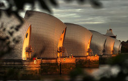 Thames Barrier. The Thames flood barrier at Grewnwich, London at sunset Stock Photo