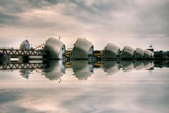 Thames Barrier. Tidal protector, commissioned by the Greater London Council, was complete by 1982, the world's second largest movable flood barrier, on Oct 6 Stock Photos