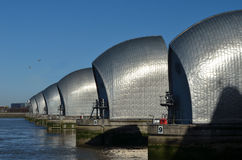 Thames barrier. The Thames barrier protecting London from flooding caused by tidal surges. The barrier has 10 steel gates that can be raised into position across stock photos
