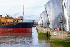 Thames Barrier with an approaching ship. Thames Barrier in London with an approaching ship Stock Images