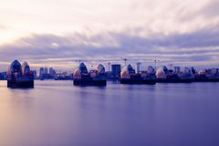 Thames Barrier and Canary Wharf in London. Long exposure photography, Thames Barrier and Canary Wharf in London Royalty Free Stock Image
