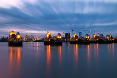 Thames Barrier and Canary Wharf in London. Long exposure photography, Thames Barrier and Canary Wharf in London Stock Photo