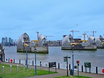 Thames Barrier flood control dam. The Thames Path allows cyclists and walkers to enjoy views all along the river, such as the Thames Barrier flood control stock photos