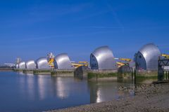The Thames Barrier flood defence gates. Side view of the Thames Barrier flood defence gates on a sunny day in London Royalty Free Stock Image