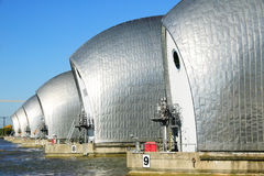 Thames Barrier,. The Thames Barrier, Greenwich, London, England, UK, shown in operation with it's flood gates closing. The Barrier was built between 1974-82 and Royalty Free Stock Images