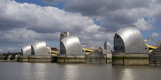 The Thames Barrier in London. The Thames Barrier on a bright and Sunny Summers day royalty free stock image
