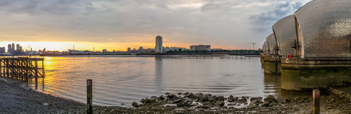 Thames barrier. London, UK -26 July 2014: London's flood barrier on river Thames and Canary Wharf Stock Image