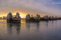 Thames barrier. London, UK -26 July 2014: London's flood barrier on river Thames and Canary Wharf Royalty Free Stock Image