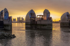 Thames barrier. London, UK -26 July 2014: London's flood barrier on river Thames and Canary Wharf Stock Photography