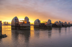 Thames barrier. London, UK -26 July 2014: London's flood barrier on river Thames and Canary Wharf Royalty Free Stock Photos