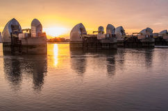 Thames barrier. London, UK -26 July 2014: London's flood barrier on river Thames and Canary Wharf Royalty Free Stock Images
