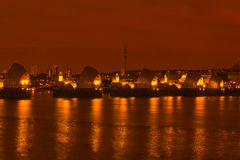Thames Barrier, London UK - at night. Thames Barrier, the world's second largest movable flood barrier which protects London from environmental flooding at night Stock Photo