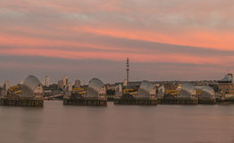 Thames Barrier, London UK. Thames Barrier, the world's second largest movable flood barrier which protects London from environmental flooding -  at dawn Stock Image
