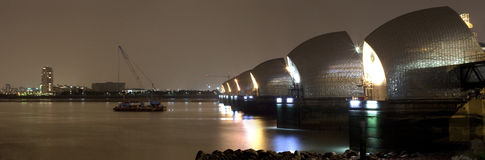 Thames Barrier at Night Panoramic. A night-time panoramic shot of the Thames Barrier in London Royalty Free Stock Image
