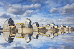 Thames Barrier Reflection London UK. 5 March 2015: London, UK - Thames Barrier reflected in the River Thames stock image