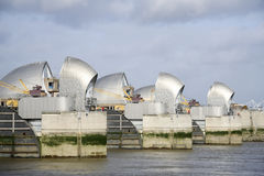 Thames barrier flood defense river thames london uk. Londons thames barrier flood defenses crossing the river near greenwich at low tide royalty free stock photo