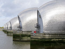 Thames barrier river thames london uk. Londons thames barrier flood defenses crossing the river near greenwich england Stock Images