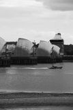 Thames Barrier and RNLI lifeboat, London. An RNLI lifeboat passes through the Thames Barrier, London Stock Photo