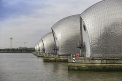Thames Barrier. View of the Thames Barrier, showing six of the nine concrete piers. Thames Barrier ius the worlds second largest movable flood barrier, located royalty free stock photography