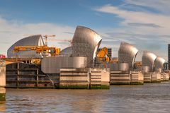 Thames Barrier in Woolwich, London, United Kingdom. London, United Kingdom - June 23, 2018: Thames Barrier in Woolwich, London, United Kingdom viewed from stock photos