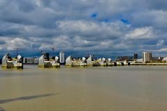 The river Thames and the thames barriers. The thames barriers across the thames river is a flood defensive system to protect flooding in surrounding areas royalty free stock photo