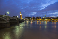 Thames and Big Ben. The River THames and the Big Ben at night being illuminated by the city lights, London, England Royalty Free Stock Images