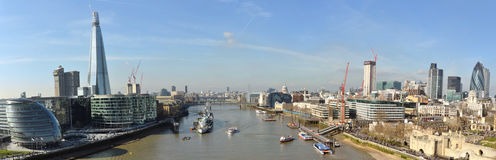 Thames London City bent panorama from Tower Bridge. Slightly bent panorama of the City, business center, taken from the Tower Bridge in London, United Kingdom Stock Photos