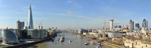 Thames and London City panorama from Tower Bridge. Panorama of the City, business center, taken from the Tower Bridge in London, United Kingdom Royalty Free Stock Photo