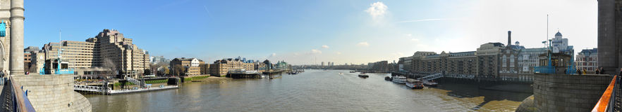 Thames panoramic view from Tower Bridge, London. Panorama taken from the Tower Bridge in London, United Kingdom Royalty Free Stock Photography