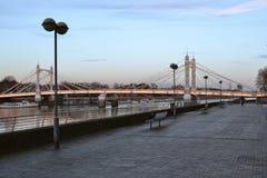 Thames Path and Albert Bridge London. Part of Thames Path and Albert Bridge in London, England at dusk Royalty Free Stock Photos