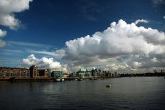 Thames river. London river Thames with nice blue sky, white clouds and building royalty free stock image