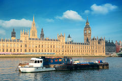 Thames River. Big Ben and House of Parliament in London with boat in Thames River royalty free stock images